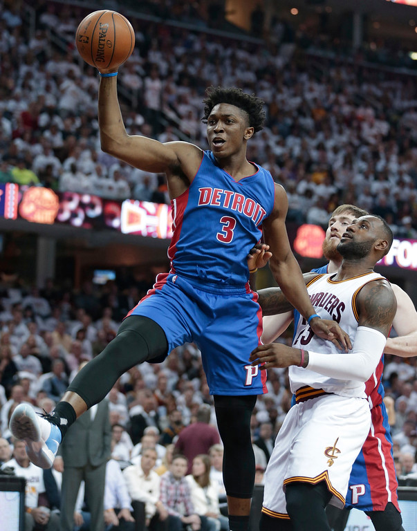 . Detroit Pistons\' Stanley Johnson (3) grabs a rebound in front of Cleveland Cavaliers\' LeBron James (23) in the first half in Game 2 of a first-round NBA basketball playoff series, Wednesday, April 20, 2016, in Cleveland. (AP Photo/Tony Dejak)