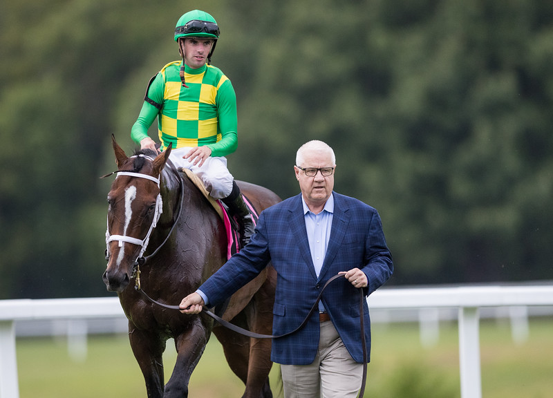 Owner Jerry Crawford leads Arklow, (Arch, Florent Geroux up),  after winning the $750,000 G3 Calumet Farm Kentucky Turf Cup Stakes for owners Donegal Racing LLC, Joseph Bulger, and Peter Coneway and trainer Brad Cox.