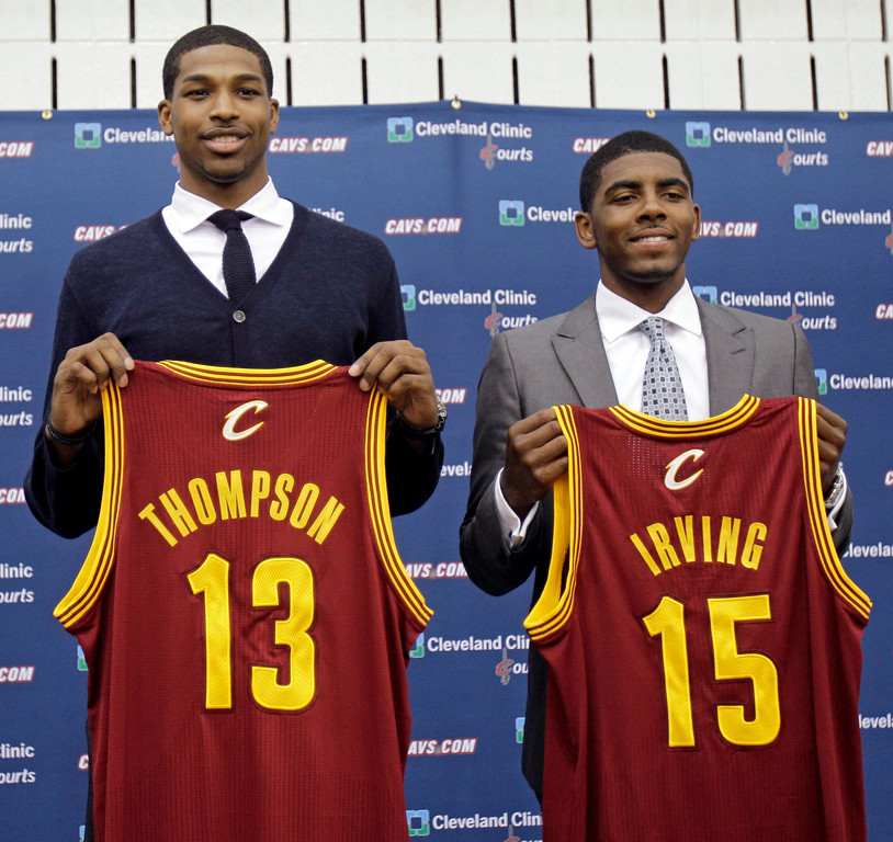 . Tristan Thompson, left, and Kyrie Irving hold up Cleveland Cavaliers jerseys, Friday, June 24, 2011, in Independence, Ohio. Irving was the No. 1 overall pick in the 2011 NBA basketball draft and Thompson was the No. 4 overall pick. (AP Photo/Tony Dejak)