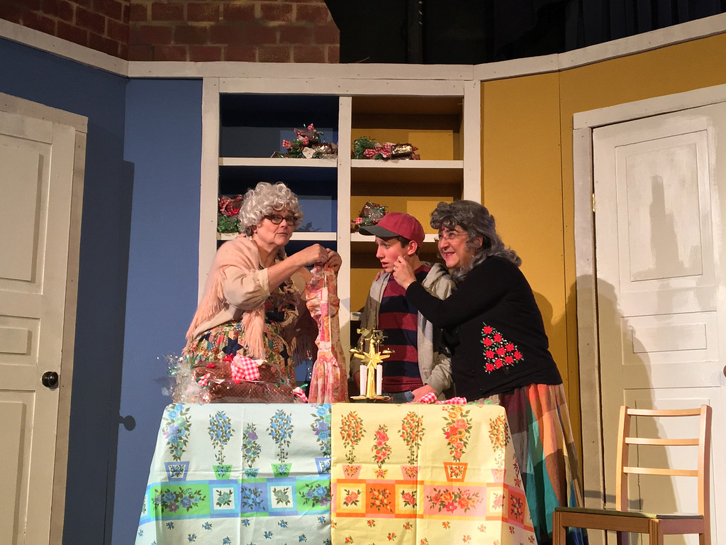 ". Fruitcake baking sisters (Tina Burgett-Krause and Civia Wiesner) rope fruitcake snitching runaway (Jack Kane) into kitchen service at Geauga Lyric Theater\'s production of ""Fruitcakes,\"" Dec. 2-18.  For more information, visit <a href=\""http://www.geaugatheater.org/\"">geaugatheater.org</a>. (Submitted)"