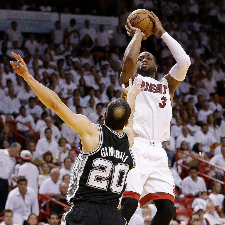 . Miami Heat shooting guard Dwyane Wade (3) shoots against San Antonio Spurs shooting guard Manu Ginobili (20) during the first half of Game 6 of the NBA Finals basketball game, Tuesday, June 18, 2013 in Miami. (AP Photo/Lynne Sladky)