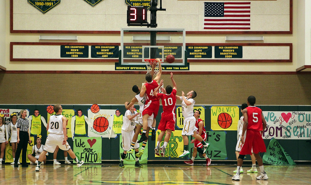 . San Ramon Valley and Monte Vista battle for the rebound in the first half of their varsity boys basketball game in Danville, Calif., on Friday, Feb. 15, 2013. (Anda Chu/Staff)