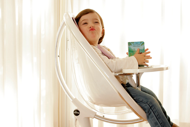 Mima_Moon_Lifestyle_White_Highchair_Child_Making_Faces.jpg