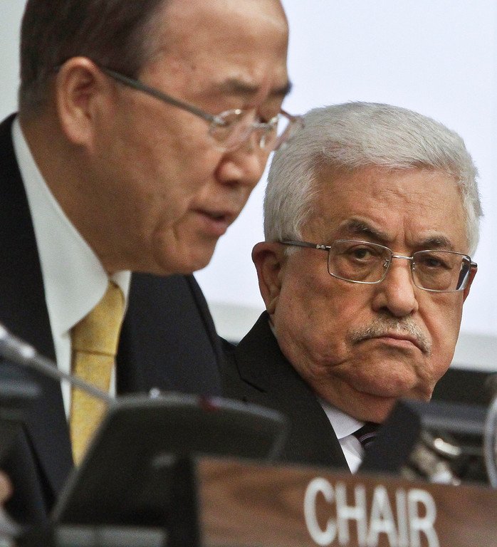 . Palestinian President Mahmoud Abbas, right, listens as U.N. Secretary-General Ban Ki-moon speaks during a meeting on Palestine, Thursday, Nov. 29, 2012. Palestinians are expected to win U.N. recognition as a state, even as the U.S., Israel\'s closest ally, mounts an aggressive campaign to head off the General Assembly vote.  (AP Photo/Bebeto Matthews)