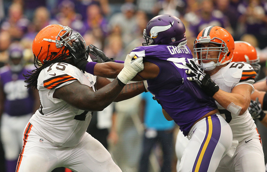 . Everson Griffen #97 of the Minnesota Vikings puts the block on Oniel Cousins #75 of the Cleveland Browns on September 22, 2013 at Mall of America Field at the Hubert Humphrey Metrodome in Minneapolis, Minnesota. (Photo by Adam Bettcher/Getty Images)