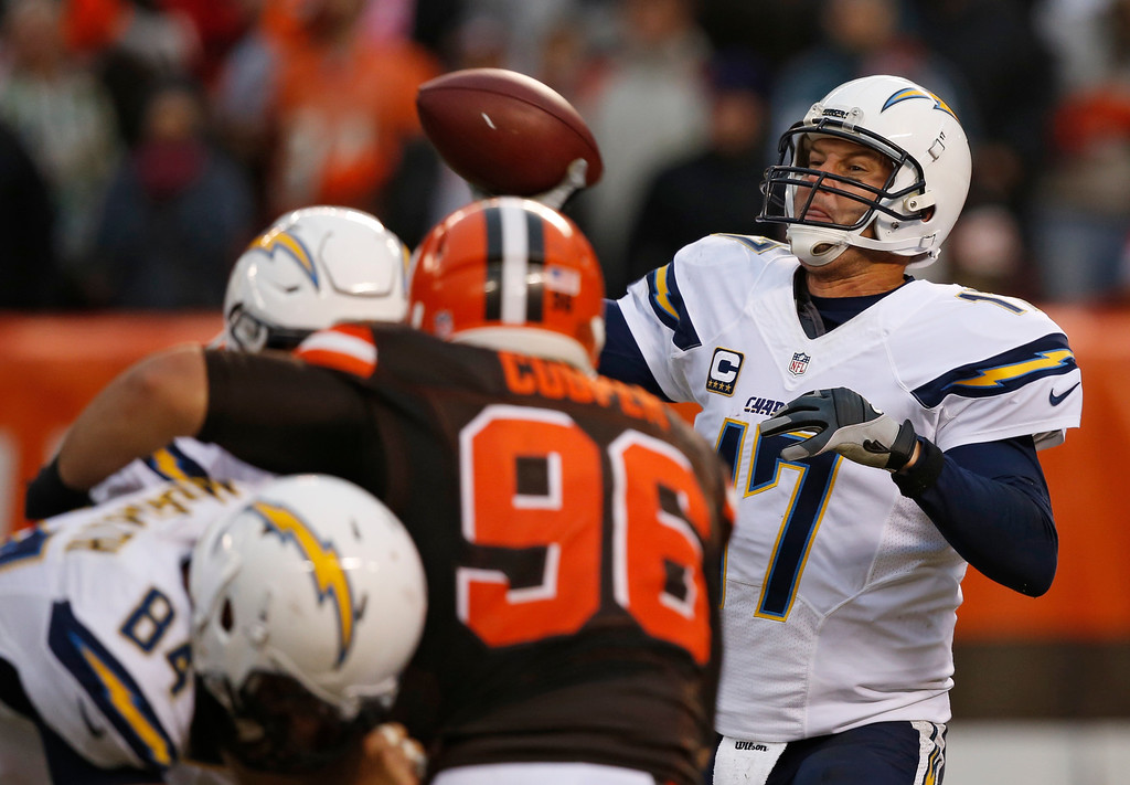. San Diego Chargers quarterback Philip Rivers (17) passes in the second half of an NFL football game against the Cleveland Browns, Saturday, Dec. 24, 2016, in Cleveland. (AP Photo/Ron Schwane)
