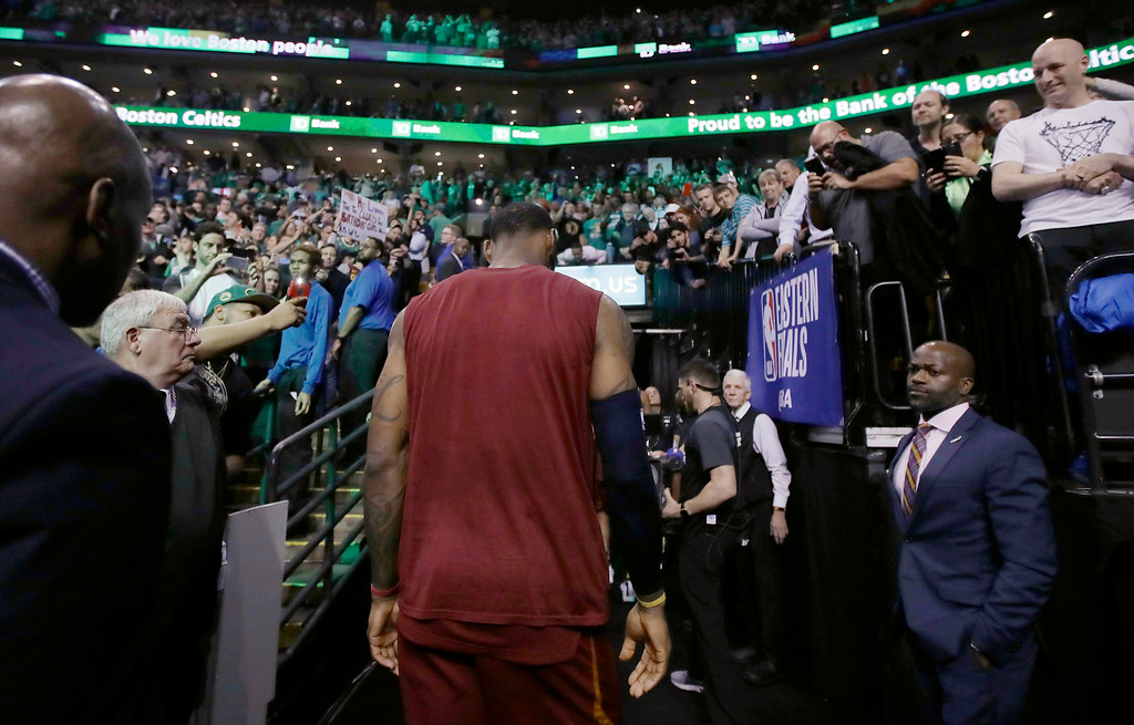 . Cleveland Cavaliers forward LeBron James heads off the court after the team\'s 107-94 loss to the Boston Celtics in Game 2 of the NBA basketball Eastern Conference finals Tuesday, May 15, 2018, in Boston. (AP Photo/Charles Krupa)