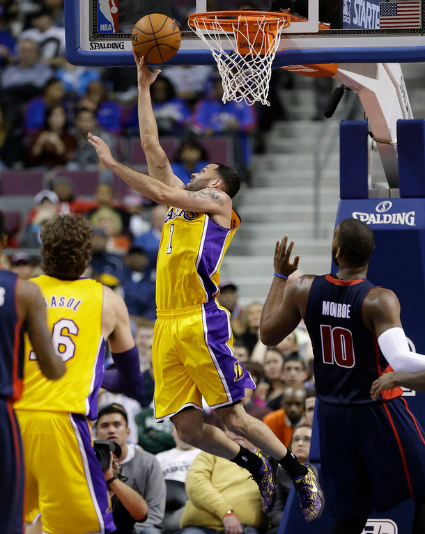 . Los Angeles Lakers guard Jordan Farmar (1) makes a layup during the second half of an NBA basketball game against the Detroit Pistons at the Palace in Auburn Hills, Mich., Friday, Nov. 29, 2013. (AP Photo/Carlos Osorio)