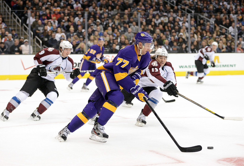 . LOS ANGELES, CA - FEBRUARY 23:  Jeff Carter #77 of the Los Angeles Kings clears his zone as P.A. Parenteau #15 and Matt Duchene #9 of the Colorado Avalanche chase at Staples Center on February 23, 2013 in Los Angeles, California.  (Photo by Harry How/Getty Images)