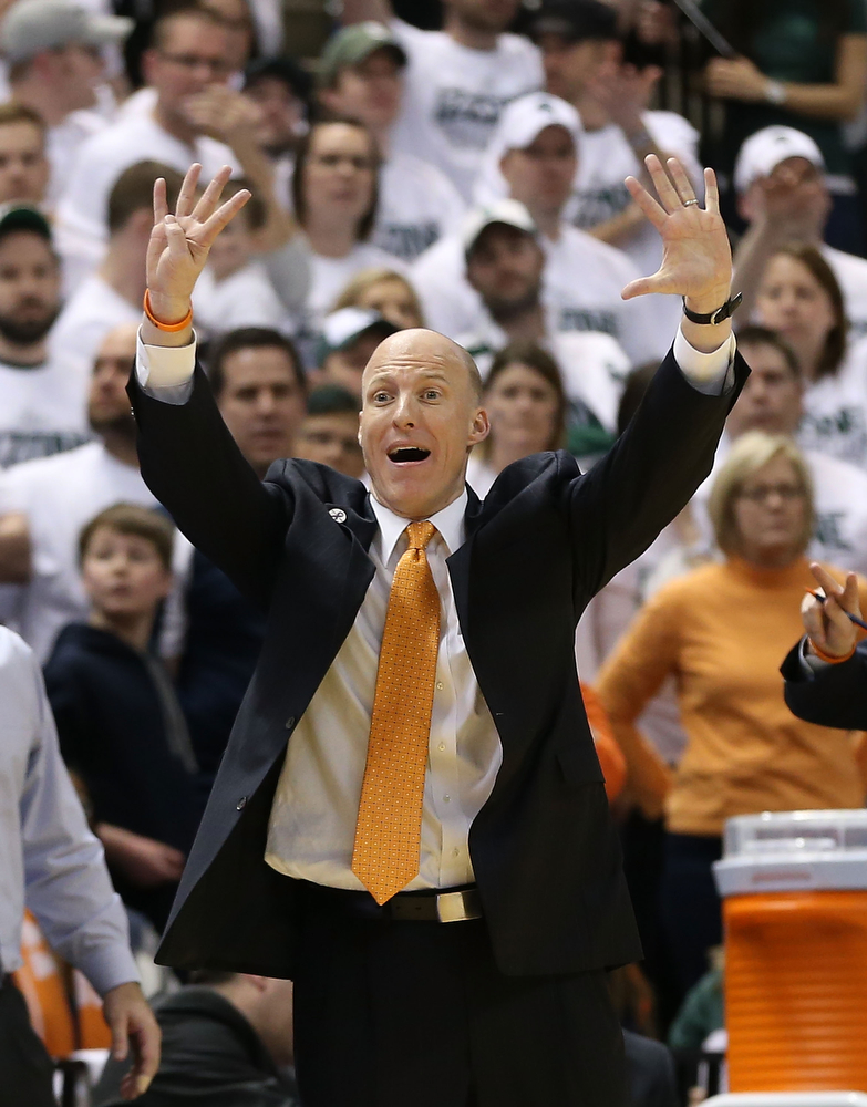 . University of Illinois head basketball coach John Groce reacts to a call late in the second half during the game against the Michigan State Spartans at Breslin Center on March 1, 2014 in East Lansing, Michigan. Illinois defeated Michigan State 53-46.  (Photo by Leon Halip/Getty Images)