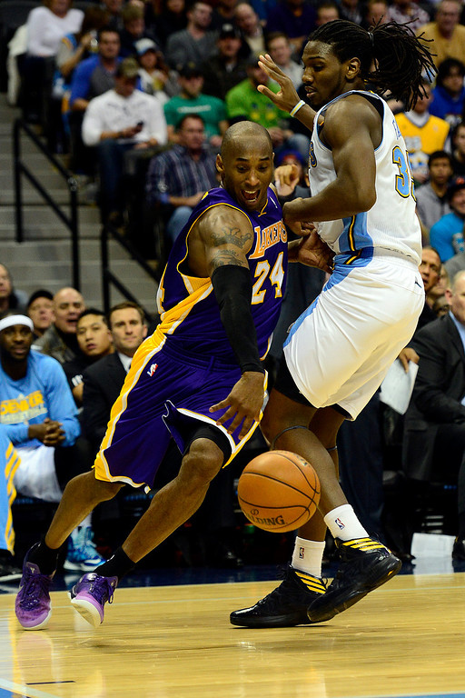 . Los Angeles Lakers shooting guard Kobe Bryant (24) drives around Denver Nuggets small forward Kenneth Faried (35) during the second half of the Nuggets\' 126-114 win at the Pepsi Center on Wednesday, December 26, 2012. AAron Ontiveroz, The Denver Post