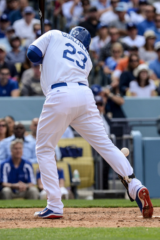 . Dodger\'s Adrian Gonzalez get hit by a pitch to get on base during the 8th inning during opening day at Dodger Stadium Monday.  Dodgers defeated the Giants 4-0.  Photo by David Crane/Los Angeles Daily News.