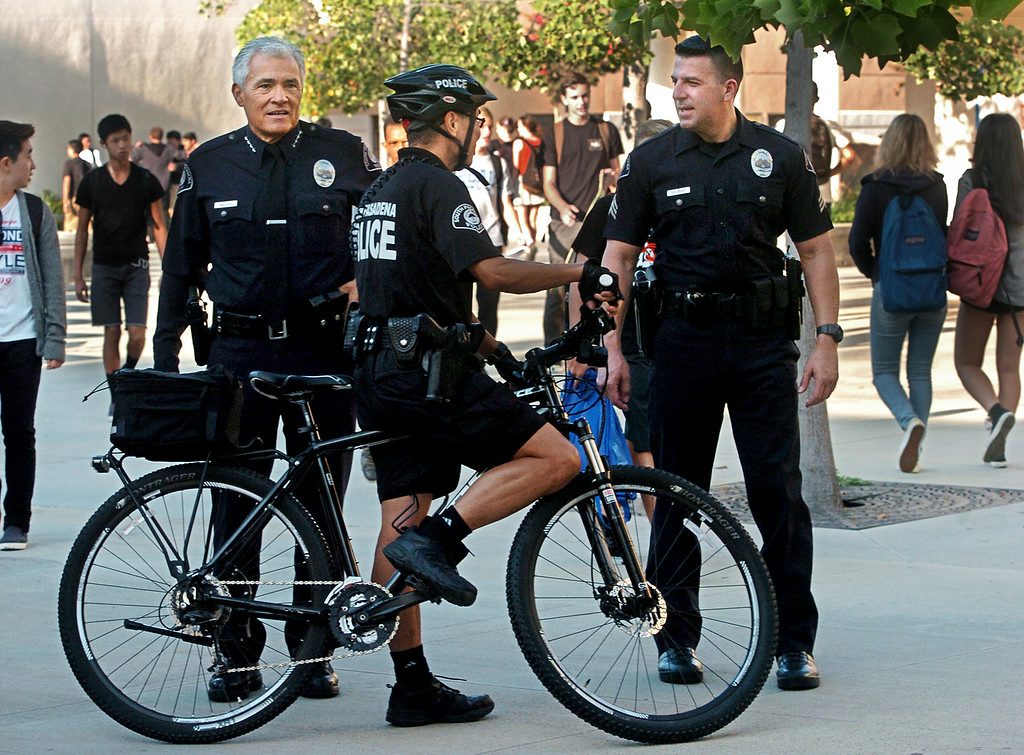 . South Pasadena Police Chief Arthur Miller, left with two of his officers on South Pasadena High School campus.South Pasadena High School\'s first day back was on Thursday, August 21, 2014. This the the campus where a 16- and 17-year-old boy allegedly planned a mass shooting to kill three staff members and as many students as possible, Police Chief Arthur Miller said. The Los Angeles County District Attorney\'s Office on Wednesday charged both boys with one count of making criminal threats. The D.A. has not charged the teens for conspiracy to commit a mass shooting, just a shooting. (Photo by Walt Mancini/Pasadena Star-News)