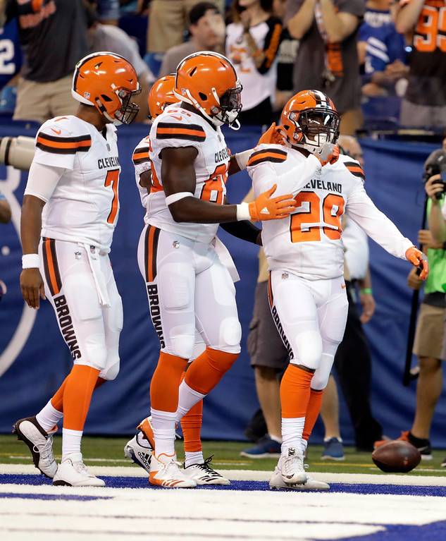 . Cleveland Browns running back Duke Johnson (29) celebrates a touchdown with wide receiver Rashard Higgins (81) and quarterback DeShone Kizer (7) during the first half of an NFL football game against the Indianapolis Colts in Indianapolis, Sunday, Sept. 24, 2017. (AP Photo/Darron Cummings)