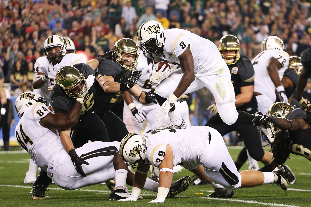 . GLENDALE, AZ - JANUARY 01:  Storm Johnson #8 of the UCF Knights runs the ball in the first quarter against the Baylor Bears during the Tostitos Fiesta Bowl at University of Phoenix Stadium on January 1, 2014 in Glendale, Arizona.  (Photo by Christian Petersen/Getty Images)