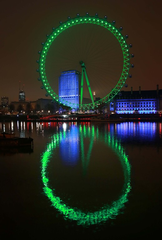 . This image supplied by Tourism Ireland on Monday March 16, 2015 shows the London Eye floodlit green to celebrate St Patrick\'s Day on Tuesday. Landmark buildings across Ireland and the world have been floodlit green as global celebrations of the Emerald Isle\'s patron saint are culminating in parades and celebrations in Dublin and other cities, particularly in the U.S., on St. Patrick\'s Day. (AP Photo/Matt Alexander, Tourism Ireland)