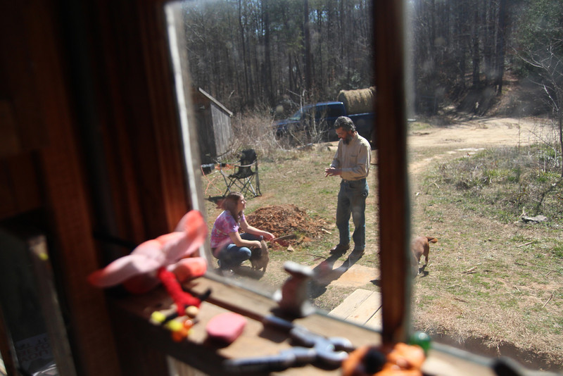 Stephanie Capps talks to her Uncle John outside of his cabin home.