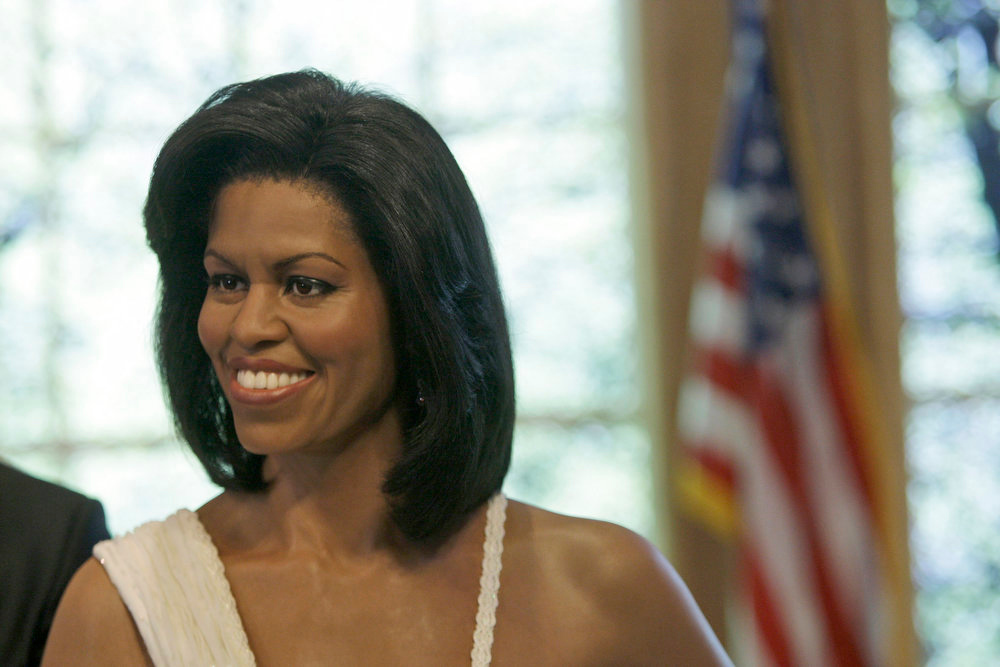 Description of . A wax figure of First Lady Michelle Obama is unveiled at Madame Tussauds  in New York to kick off Black History month Tuesday, Jan. 26, 2010. (AP Photo/Frank Franklin II)