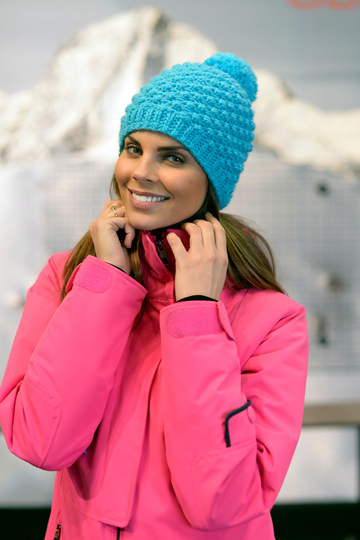 . A model in a jacket and hat from Aspen-based Obermeyer  during a visit to the Snowsports Industries America  Snow Show at the Colorado Convention Center in Denver on Thursday, January 30, 2014. (Denver Post Photo by Cyrus McCrimmon)