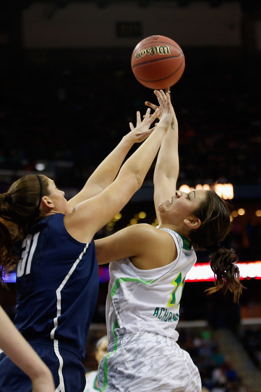 . Natalie Achonwa #11 of the Notre Dame Fighting Irish makes a shot over Stefanie Dolson #31 of the Connecticut Huskies during the National Semifinal game of the 2013 NCAA Division I Women\'s Basketball Championship at the New Orleans Arena on April 7, 2013 in New Orleans, Louisiana.  (Photo by Chris Graythen/Getty Images)