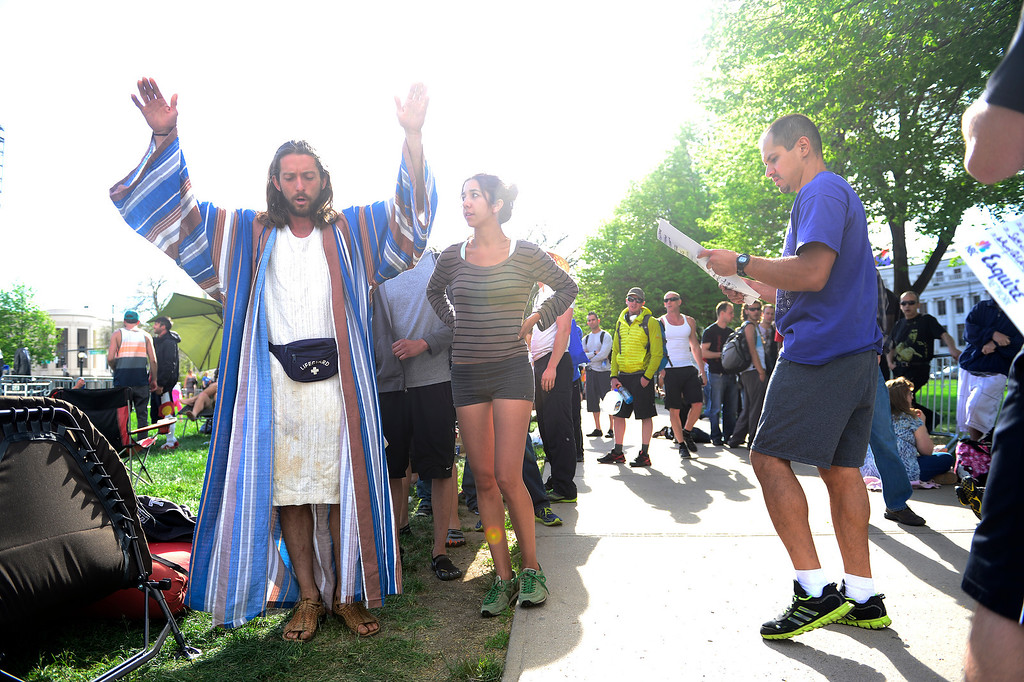 . Isaac Caldiero (dressed as Jesus Christ) and his girlfriend, Laura Kisana wait in line before the tryout for American Ninja Warrior Denver on on May 19, 2013. (Photo by AAron Ontiveroz/The Denver Post)