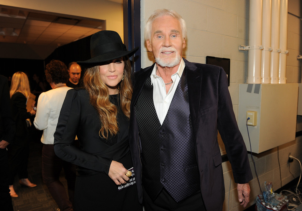 . Lisa Marie Presley, left, and Kenny Rogers pose backstage at the 2013 CMT Music Awards at Bridgestone Arena on Wednesday, June 5, 2013, in Nashville, Tenn. (Photo by Frank Micelotta/Invision/AP)