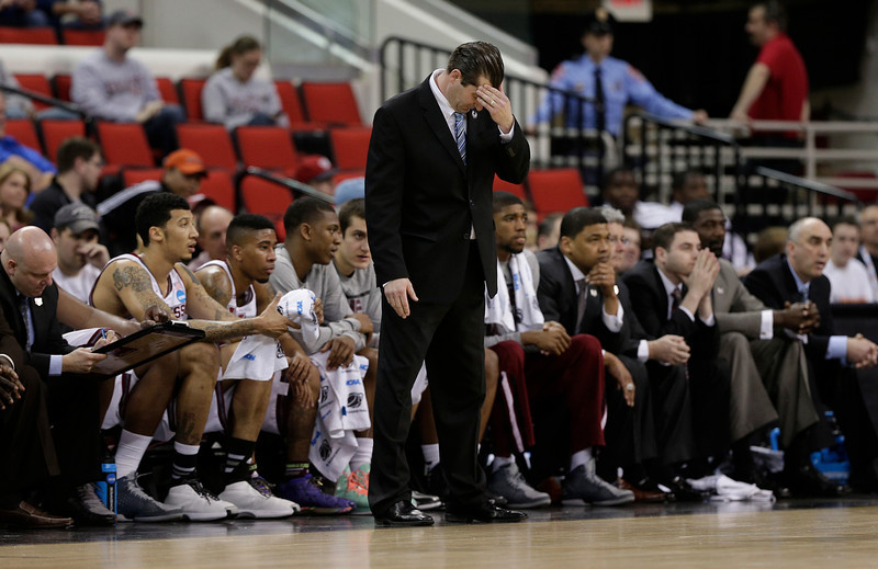 . Massachusetts head coach Derek Kellogg reacts to play against Tennessee during the first half of an NCAA college basketball second-round tournament game, Friday, March 21, 2014, in Raleigh. (AP Photo/Chuck Burton)