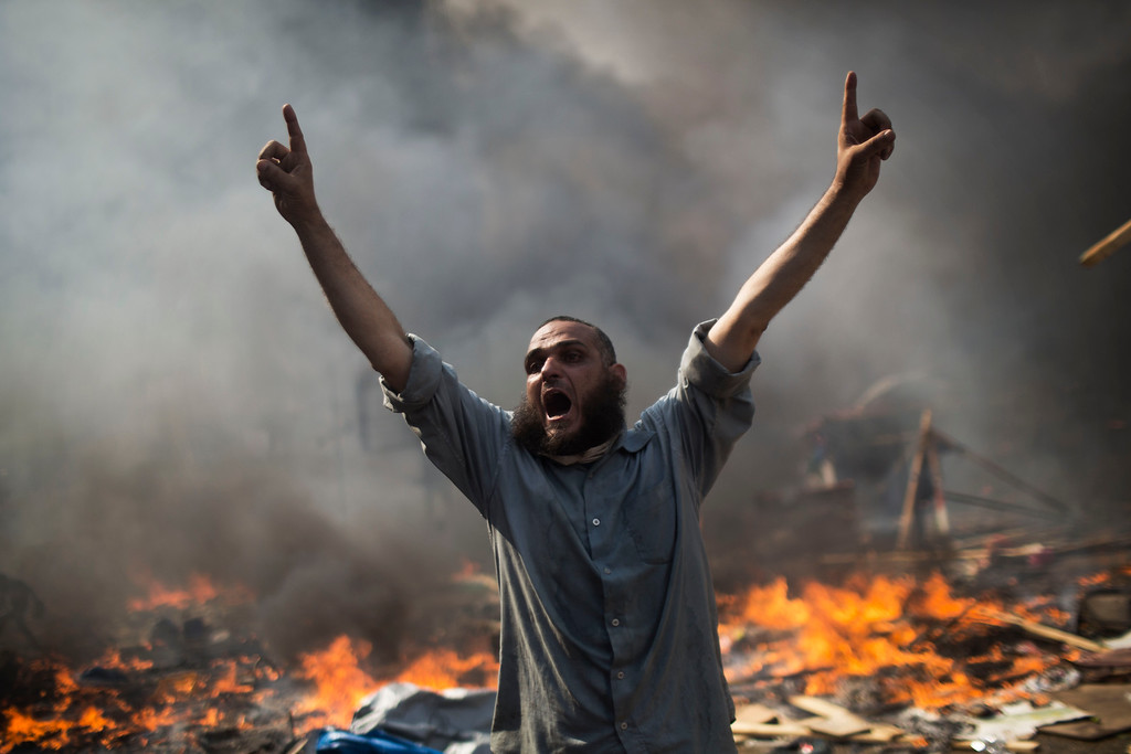 . A supporter of ousted Islamist President Mohammed Morsi shouts during clashes with Egyptian security forces in Cairo\'s Nasr City district, Egypt, Wednesday, Aug. 14, 2013.  (AP Photo/Manu Brabo)