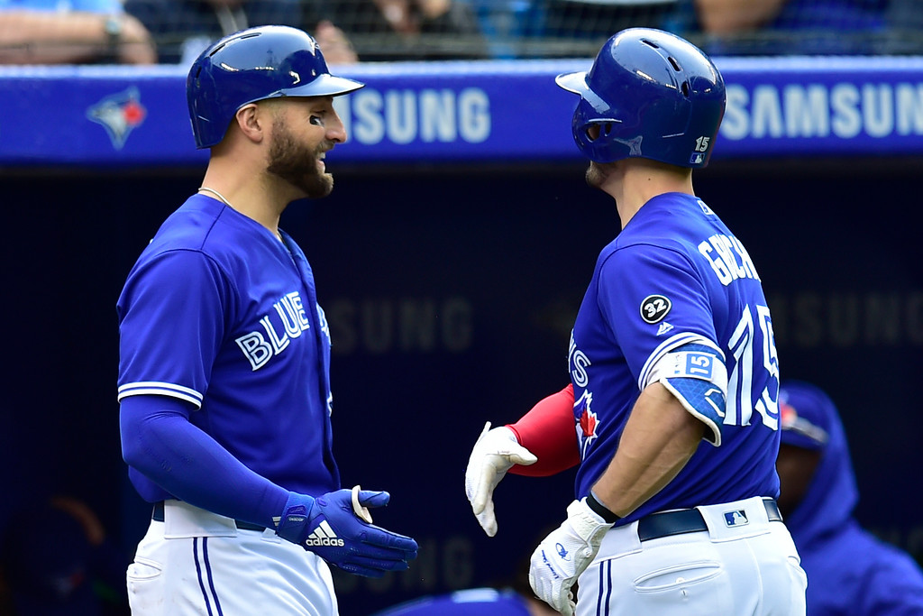 . Toronto Blue Jays\' Randal Grichuk, right, is congratulated by Kevin Pillar after hitting a solo home run against the Cleveland Indians during the third inning  of a baseball game in Toronto, Saturday, Sept .8, 2018. (Frank Gunn/The Canadian Press via AP)
