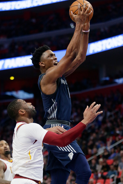 . Detroit Pistons forward Stanley Johnson, right, goes to the basket past Cleveland Cavaliers guard Dwyane Wade, left, during the first half of an NBA basketball game Tuesday, Jan. 30, 2018, in Detroit. (AP Photo/Duane Burleson)