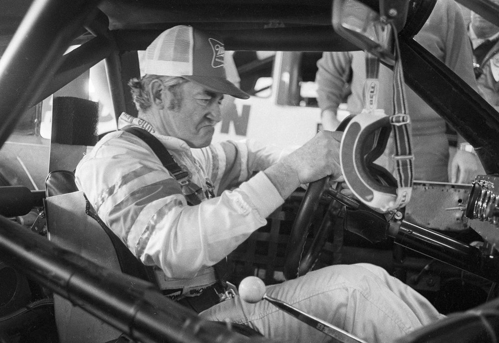 . Race car driver Bobby Allison of Hueytown, Ala., has a look of determination on his face as he tries his third race car out for the first time, at Daytona Beach, Fla., Feb. 16, 1983.  Defending Daytona 500 champion, Allison wrecked his second car in two days yesterday during practice and another car was shipped from Charlotte, N.C. in time for him to qualify with a speed of 191.307 mph.  (AP Photo/Pete Wright)