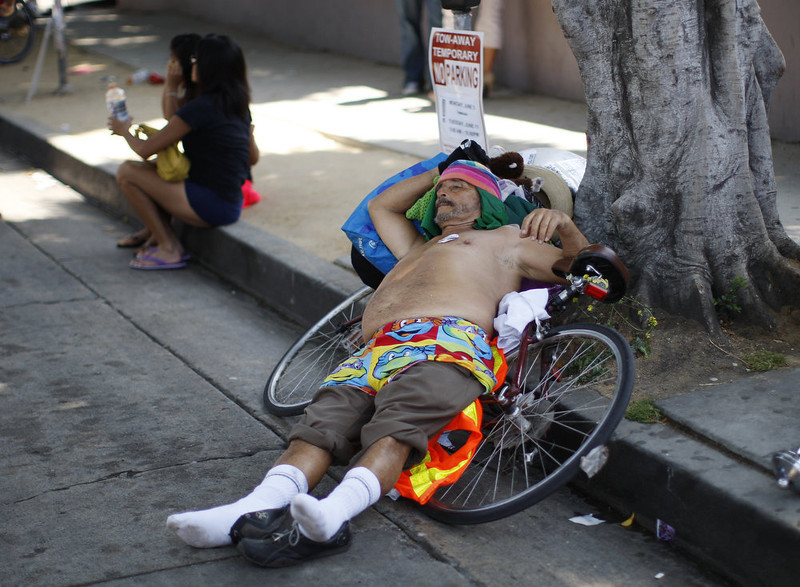 . A man rests on a bicycle at the 43rd L.A. Pride Parade on June 9, 2013 in West Hollywood, California. More than 400,000 people are expected to attend the parade in support of lesbian, gay, bisexual and transgender communities.  (Photo by David McNew/Getty Images)