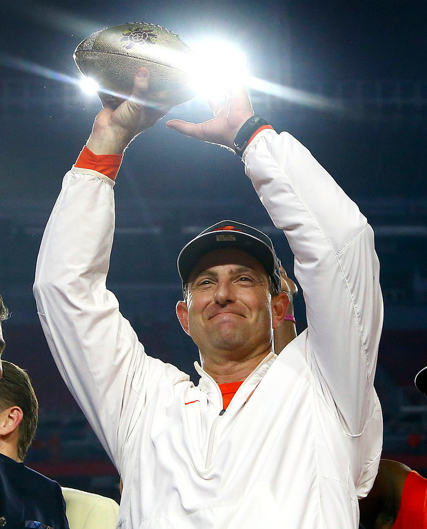 . Clemson coach Dabo Swinney holds the trophy after the team\'s Fiesta Bowl NCAA college football playoff semifinal against Ohio State, Saturday, Dec. 31, 2016, in Glendale, Ariz. Clemson won 31-0 to advance to the BCS championship game against Alabama. (AP Photo/Ross D. Franklin)
