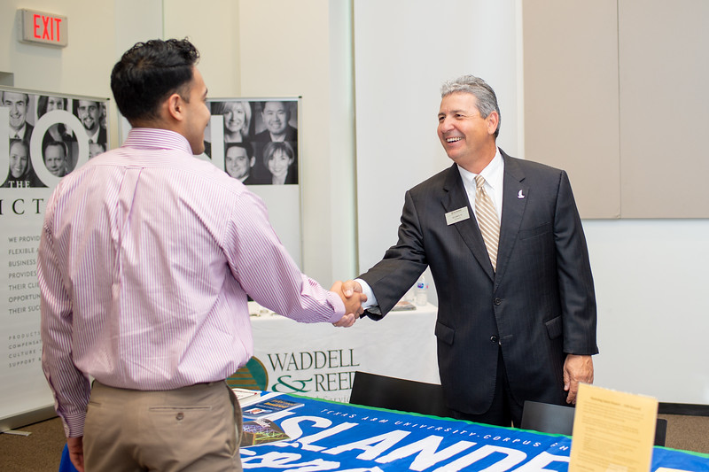 Islander Alumni, Ben Lopez (left), catches up with Ed Cantu at the College of Business' Career Fair event in the O'Connor building.
