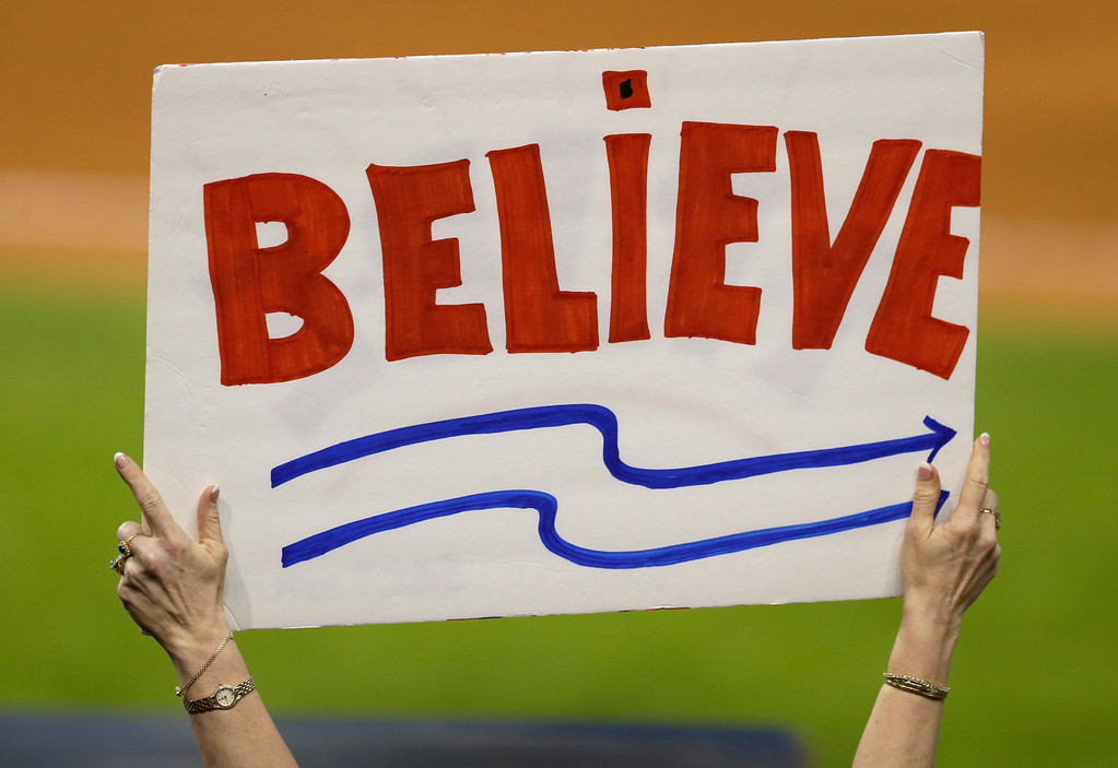 . A Cleveland Indians fan holds up a sign during a baseball game between the Detroit Tigers and the Cleveland Indians, Monday, May 19, 2014, in Cleveland. (AP Photo/Tony Dejak)