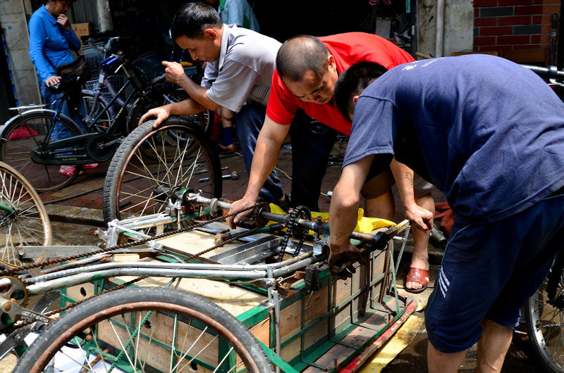 repairs occurred on the sidewalks and streets in front of little machine shops. Welding with no glasses or helmets.