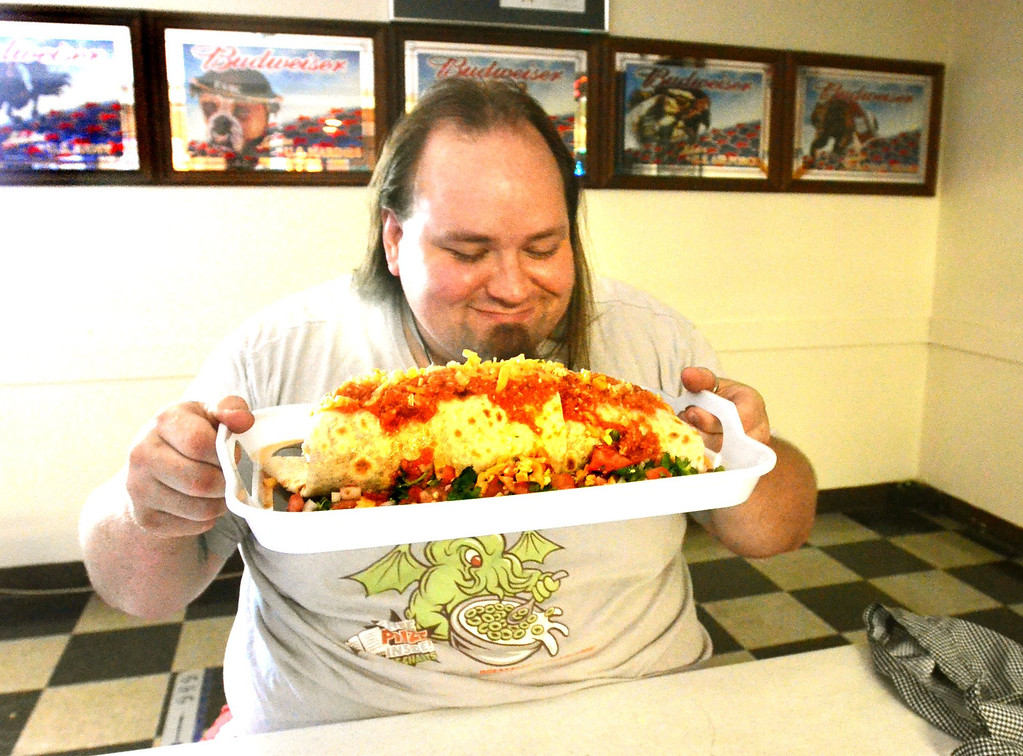 . Tymm Earl of Waterford, with a giant, three pound burrito at VFW Post 1370 in Pontiac.  People have to pay $12 if they can\'t eat the entire burrito in 45 minutes. It\'s a way for the post to raise money.    Friday, July 19, 2013.  The Oakland Press/TIM THOMPSON