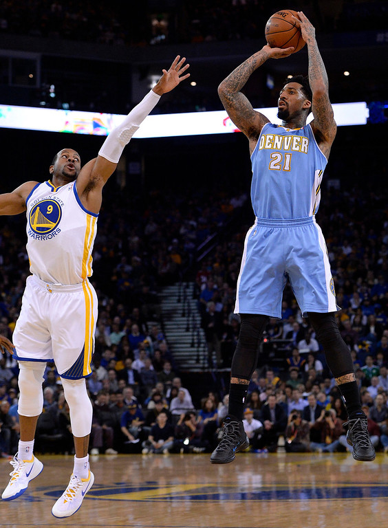 . Denver Nuggets small forward Wilson Chandler (R) shoots as Golden State Warriors small forward Andre Iguodala (L) defends during the first half of their NBA game at Oracle Arena in Oakland, California.  EPA/JOHN G. MABANGLO CORBIS OUT