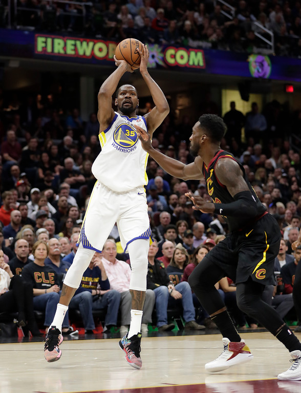 . Golden State Warriors\' Kevin Durant shoots against Cleveland Cavaliers\' Jeff Green during the first half of Game 3 of basketball\'s NBA Finals, Wednesday, June 6, 2018, in Cleveland. (AP Photo/Tony Dejak)