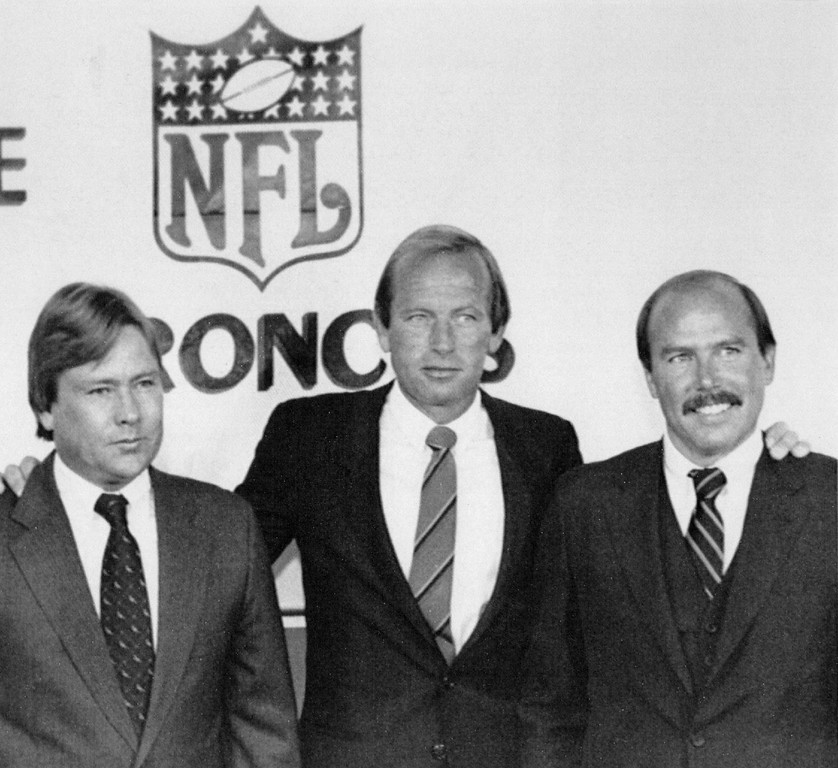 . New Bronco Owners--Patrick Bowlen, of Edmonton, Canada the new majority owner of the NFL Denver Broncos is flanked by minority owners John Adams, left, of Steamboat Springs Colo., and Tim Borden, right, a Denver attorney. The three were introduced at a news conference in Denver in 1984. Credit: AP Color Photo