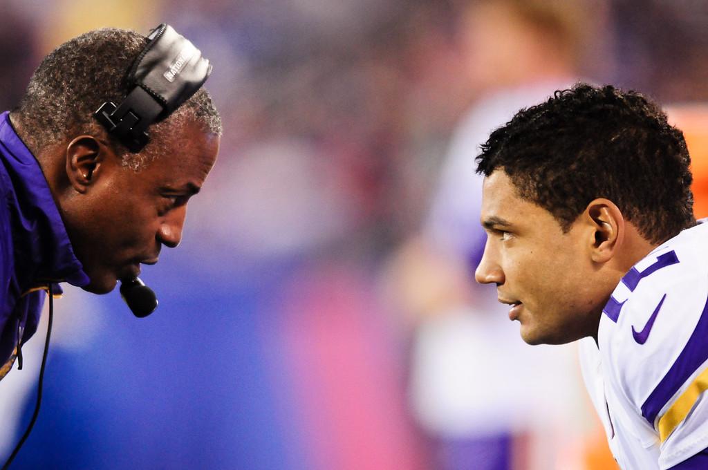 . Vikings quarterback Josh Freeman, right, and quarterbacks coach Craig Johnson discuss strategy in the first quarter against the Giants.  (Pioneer Press: Ben Garvin)