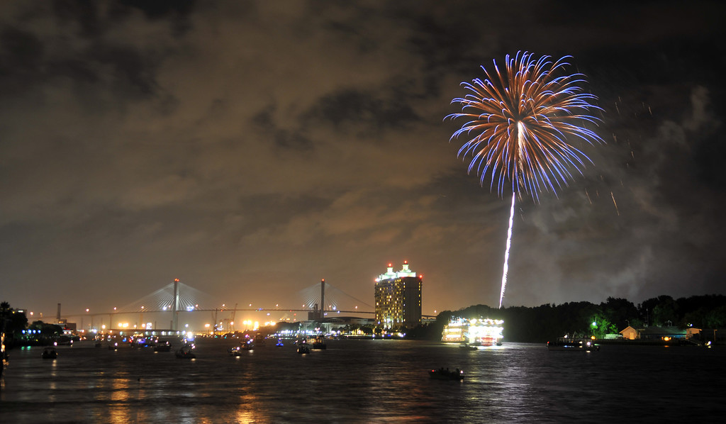 . Fireworks explode over the Savannah River during the annual Independence Day celebration Thursday, July 4, 2013, in Savannah, Ga. (AP Photo/Savannah Morning News, Richard Burkhart)