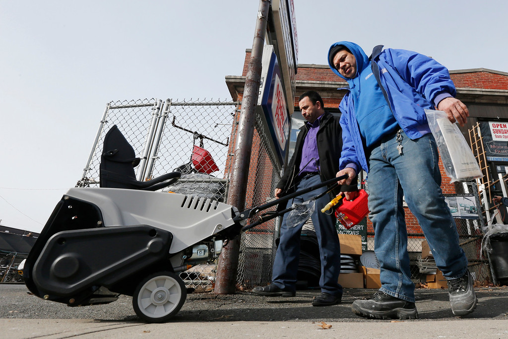 . Mario Argueta, left, of Hackensack, N.J., and friend Alex Sorto leave Meadowlands Hardware after purchasing a snow blower ahead of the weekend\'s snowstorm, Friday, Jan. 22, 2016, in Rutherford, N.J. Towns across the state are hunkering down in preparation for a major snowstorm expected to begin later in the day. (AP Photo/Julio Cortez)