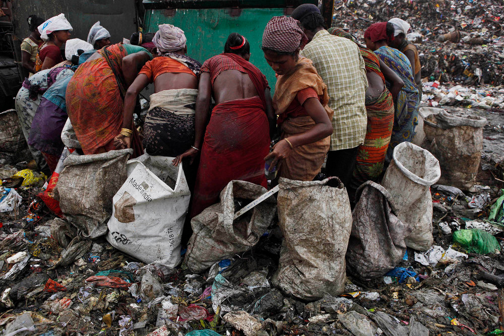 . Indian women ragpickers search for recyclable materials in a garbage dump near Deepor Beel wildlife sanctuary on the outskirts of Gauhati, India, Wednesday, June 5, 2013. The World Environment Day is celebrated June 5 every year by the United Nations to stimulate global awareness on environmental issues. (AP Photo/Anupam Nath)