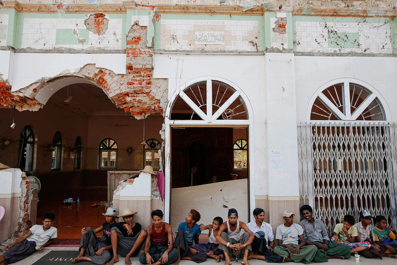 . Muslim men gather in front of a mosque heavily damaged during recent violence in the town of Gyo Bin Gauk, some 93 miles north of Yangon on April 4, 2013. Officially, 43 people died in the recent anti-Muslim violence, which erupted in Meikhtila in the centre of the country on March 20, 2013 and included the fire-bombing of mosques. It spread to at least 15 other towns and villages until President Thein Sein ordered soldiers and police to crack down.  REUTERS/Damir Sagolj