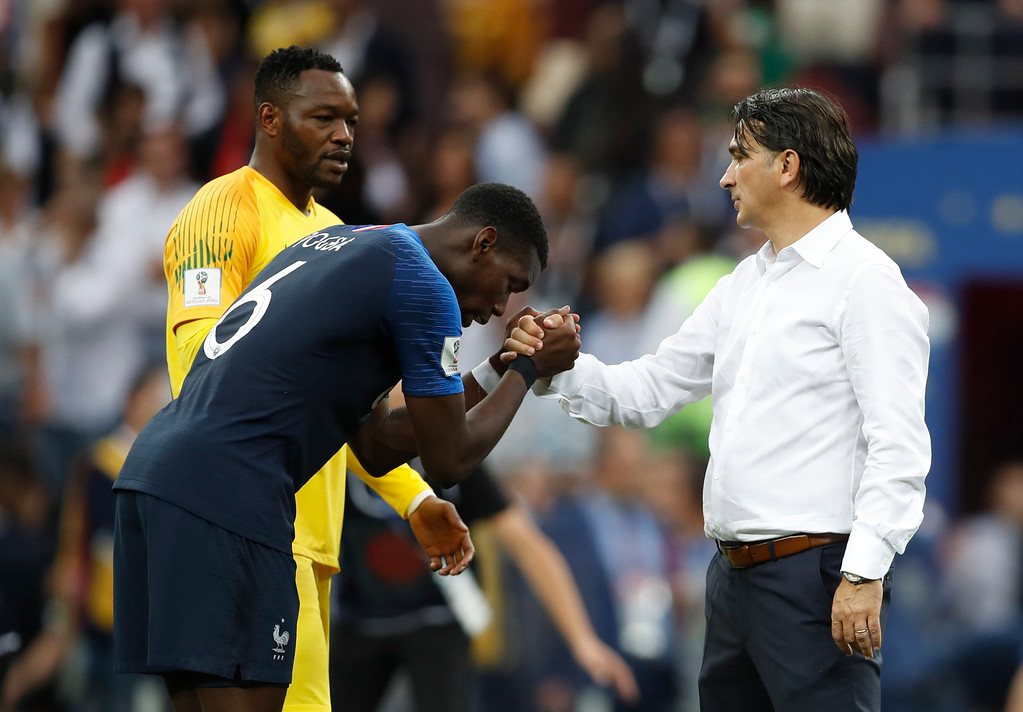 . France\'s Paul Pogba, left shakes hands with Croatia head coach Zlatko Dalic after France defeated Croatia to win the final match between France and Croatia at the 2018 soccer World Cup in the Luzhniki Stadium in Moscow, Russia, Sunday, July 15, 2018. France won the game 4-2. (AP Photo/Francisco Seco)