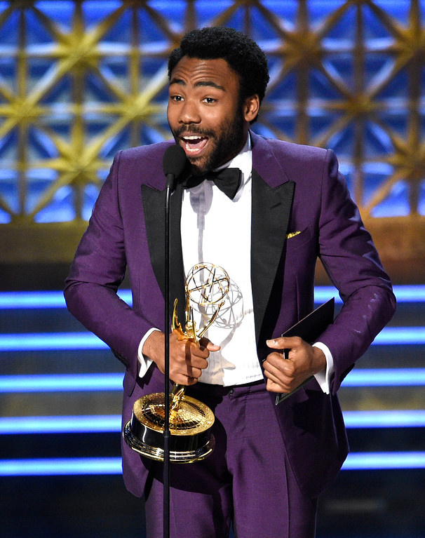 ". Donald Glover accepts the award for outstanding lead actor in a comedy series for ""Atlanta\"" at the 69th Primetime Emmy Awards on Sunday, Sept. 17, 2017, at the Microsoft Theater in Los Angeles. (Photo by Chris Pizzello/Invision/AP)"
