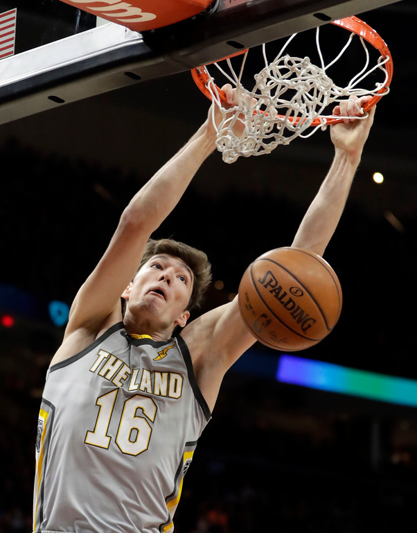 . Cleveland Cavaliers\' Cedi Osman, from Turkey, dunks the ball against the Denver Nuggets in the first half of an NBA basketball game, Saturday, March 3, 2018, in Cleveland. (AP Photo/Tony Dejak)