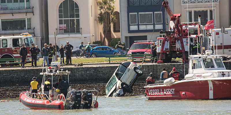 SOMEONE had driven a car into the water the previous night. Police were working on recovering the car and the bodies while the race was going on.