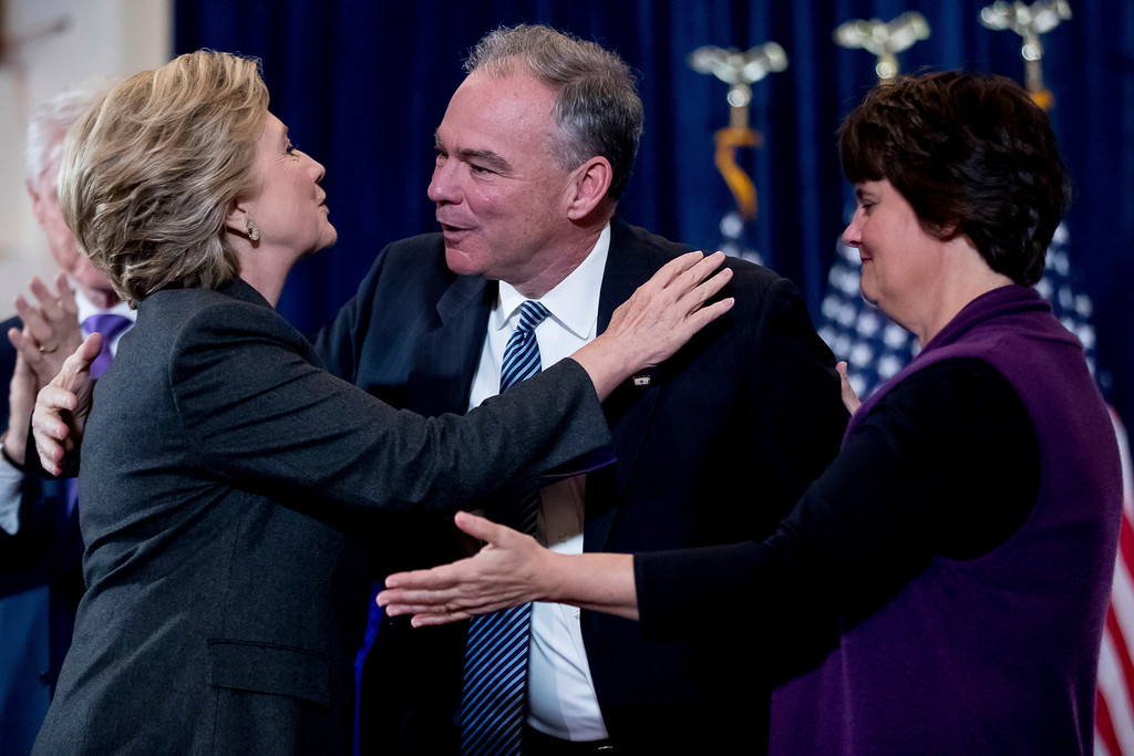 . Democratic presidential candidate Hillary Clinton, embraces her running mate, Democratic vice presidential candidate, Sen. Tim Kaine, D-Va., center, accompanied by his wife Anne Holton after speaking at the New Yorker Hotel in New York, Wednesday, Nov. 9, 2016, where she conceded her defeat to Republican Donald Trump after the hard-fought presidential election.  (AP Photo/Andrew Harnik)